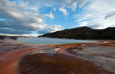 The Grand Prismatic Spring at sunset in the Midway Geyser Basin along the Firehole River in Yellowstone National Park in Wyoming USA