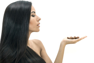 Argan oil , natural luxury treatment for skin and hair. The model carries argan seeds in her hand.
