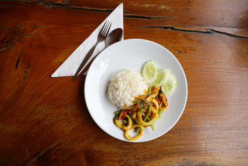 Spicy stir fried squid with yellow chilli paste with rice