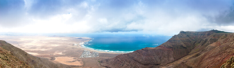 Panoramic view of the beach of Famara perfect  place for surfers. Lanzarote. Canary Islands. Spain