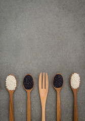esame seed in wooden spoon. Black and white sesame set up on wooden board