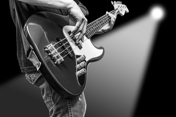 bass player & spotlight background, isolated on black for music concept