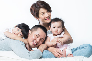 Young happy Asian family.