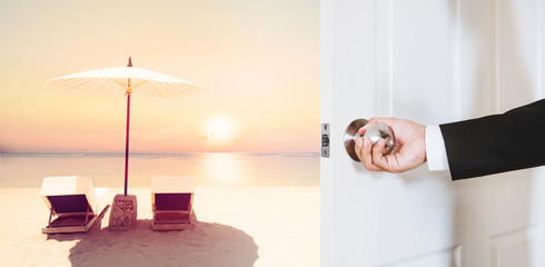 Businessman hand holding door knob, opening to the tropical beach in sunset with beach chairs and umbrella, vintage tone, business summer vacation concept