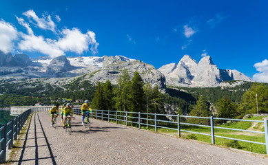 group of cyclists in movement on a mountain road