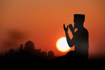 islamic prayjng at sunset.