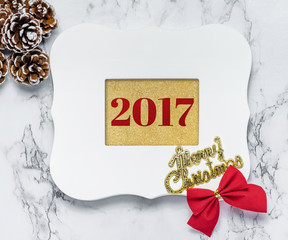 Merry christmas 2017 text in vintage white picture frame with pi