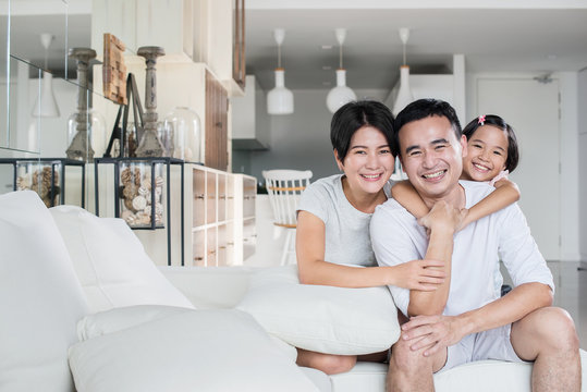 Young and happy Asian family at home.