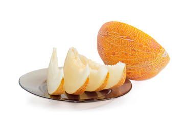 Several slices and half of melon on a light background