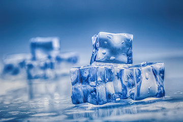 ice cubes on blue background.