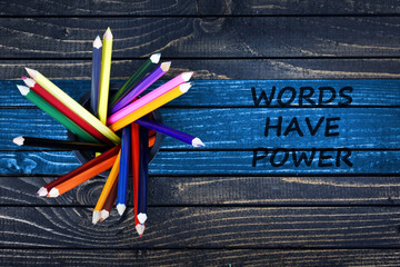 Words have power text painted and group of pencils