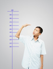 Young boy measuring his growth