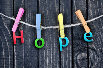 Hope word hanging on clips