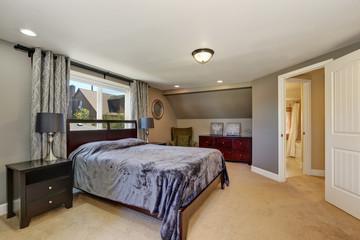 Interior design of grey tones bedroom with violet bed