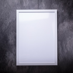 Blank white picture frame on the wall