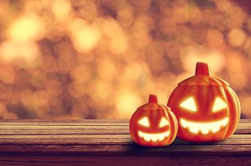 Halloween pumpkin on table wood with light orange bokeh background, halloween background concept, copy space. Fotoväggar