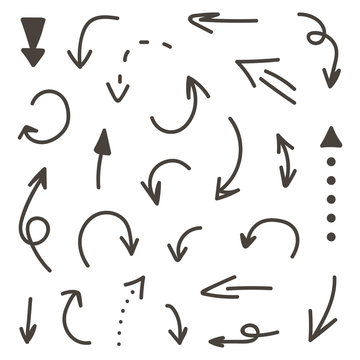 Set of monochrome hand-drawn arrows isolated on white background.