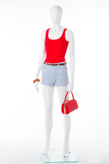 Summer red tank top, denim shorts and handbag.