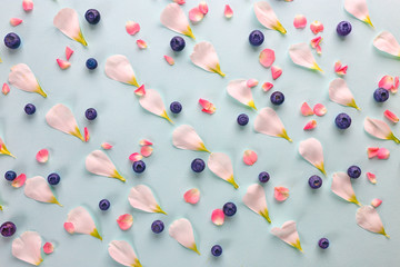 Tender pattern made of blueberries and flower petals