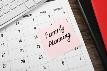 Note with text FAMILY PLANNING, closeup