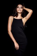 Beautiful young girl in black dress