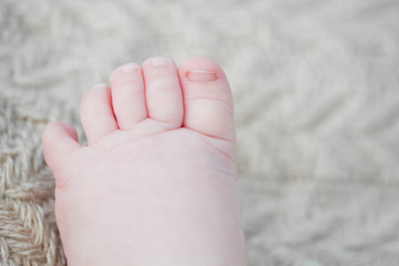 One month old baby's foot