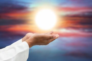 peopel praying at sunset.