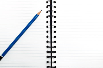 Blank notebook with pencil, business concept