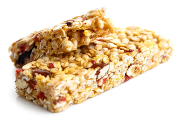 One and half muesli bars isolated on white.