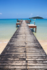 Wooden jetty on exotic beach