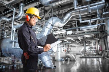 Engineer taking notes at thermal power plant factory