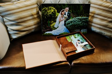 Brown leather wedding book and album with big picture on canvas