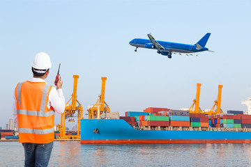 Dock worker talking with radio for controlling loading container