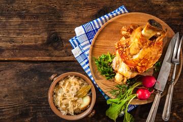 Appetizing Bavarian grilled pork knuckle with sauerkraut