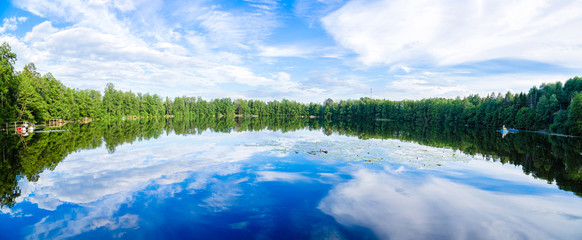 Beautiful lake with reflection of sky in water