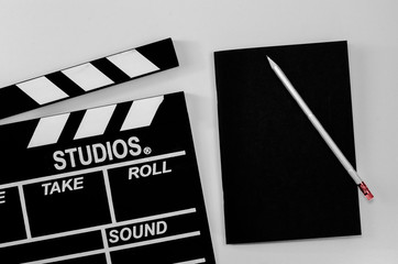 Slate film and black notebook white background