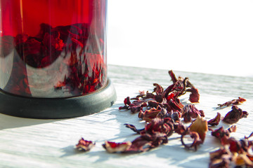 Cups of Garnet red tea on old wooden table