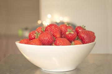 White bowl of strawberries