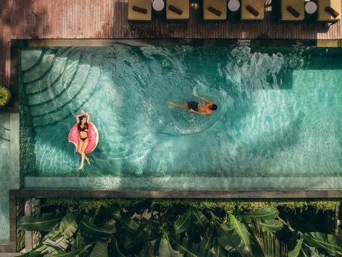 Couple relaxing in resort pool