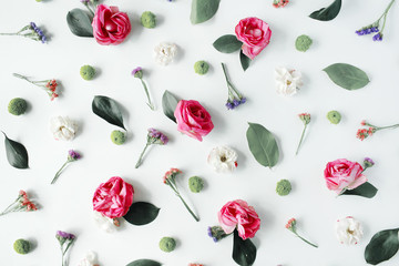 Wallpaper, texture. Pink roses and white flowers on white background. Flat lay, top view