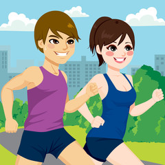 Young athlete couple jogging together at park trail
