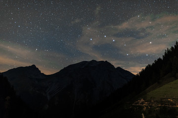 Starry night sky over the mountains of Tyrol Austria