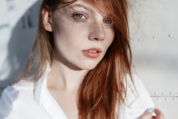 Portrait of red-haired girl close-up