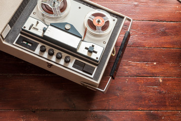 Old tape recorder on wooden background