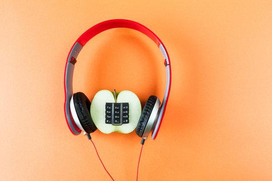 Alphanumeric apple and headphones