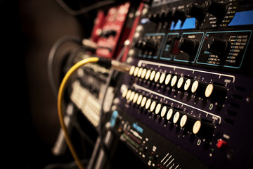 recording studio gears in rack, focus to knob & shallow dept of field