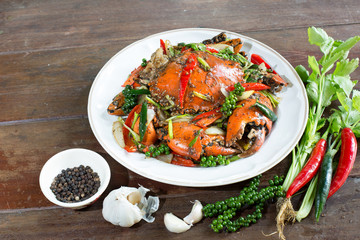 Stir fried crab with black pepper on white dish