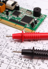 Printed circuit board and cable of multimeter on diagram of electronics