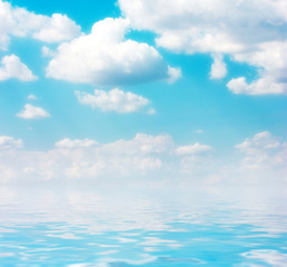 a beautiful clear sky and the water surface of the ocean