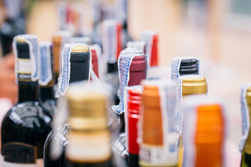 closeup wine cap and tax seal stamp for alcohol drink bottle sale in Thailand.